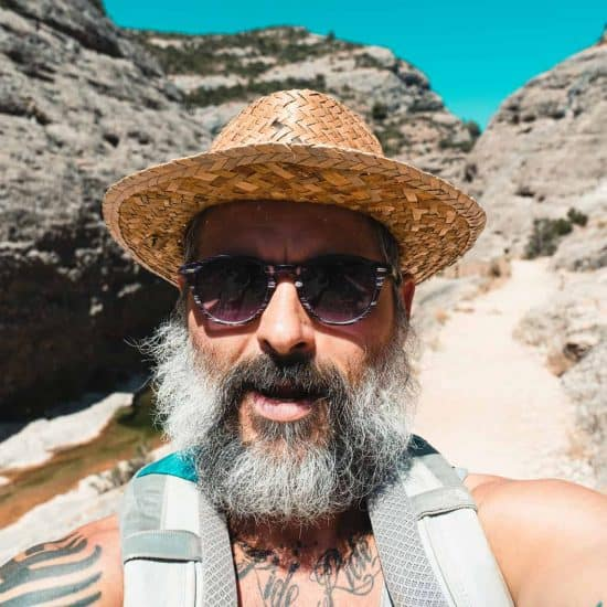 Bearded man taking a selfie in the mountains