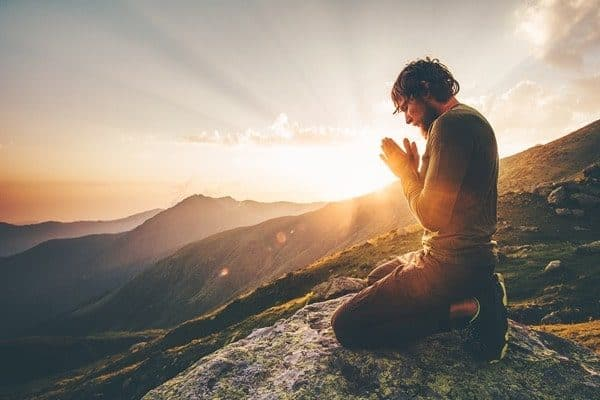 Man Praying Sunset Mountain