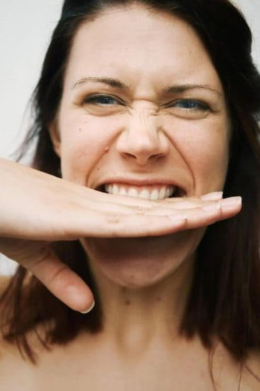 Woman Laughing Bite Hand