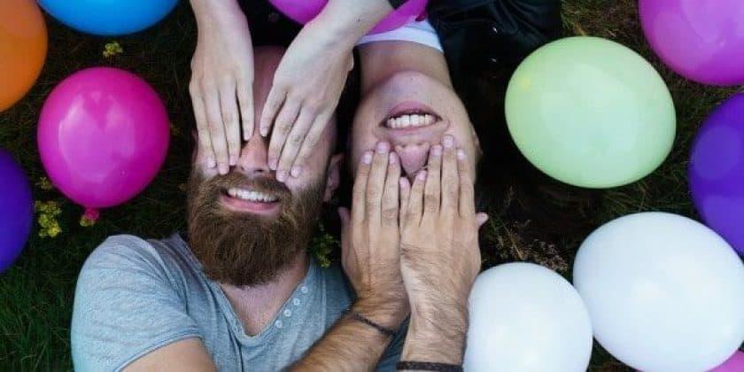 Man Woman Laugh Balloons Grass Hipster