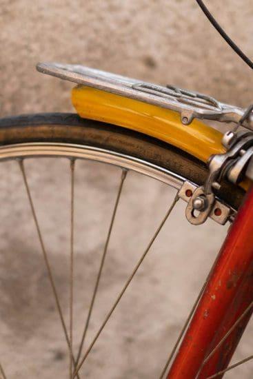 Details of a red golden vintage road bike