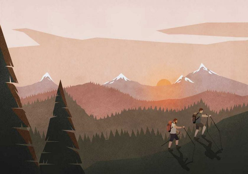 Men hiking along idyllic, tranquil sunset mountain and forest landscape