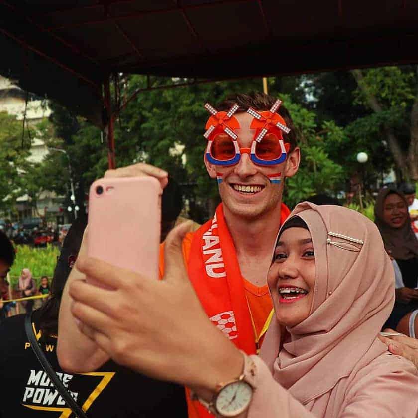 Girl with hijabi taking selfie with Dutch fan