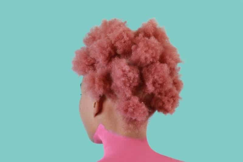 Woman with pink afro