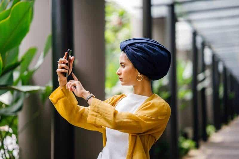 Young Muslim Malay woman taking selfie