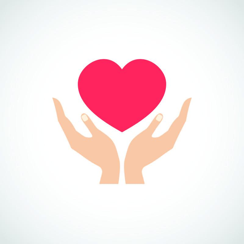 Ruce držící ilustraci srdce
