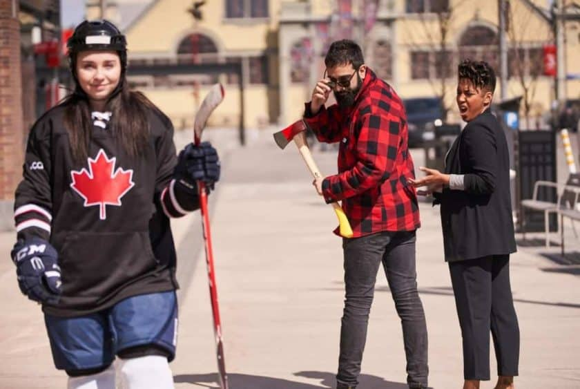 lumberjack looking at hockey player while girlfriend gets mad