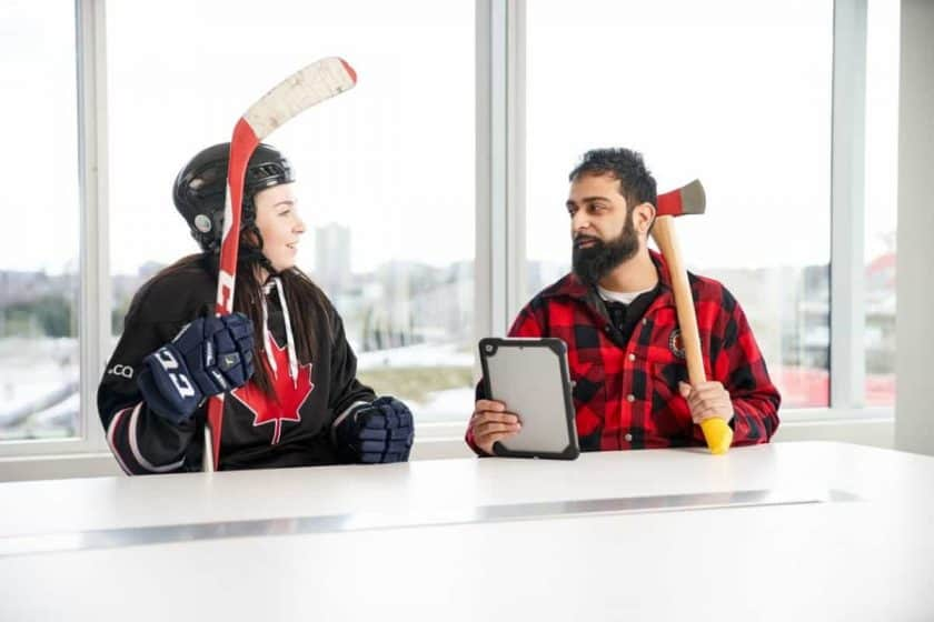 lumberjack and hockey player on office table