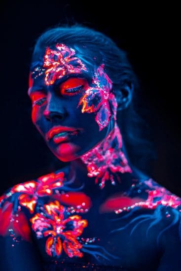 Glowing flowers painted on a woman's face