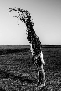 Man transforming into a tree