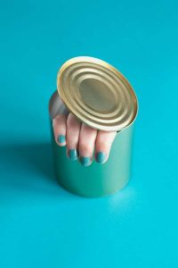 Woman's hand coming out of a can