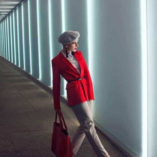 Stylish woman with red jacket bag and shoes