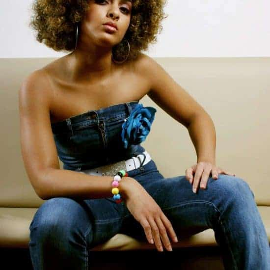 Beautiful woman of colour afro hair denim suit