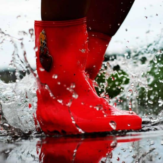 red rubber boots, water splashes