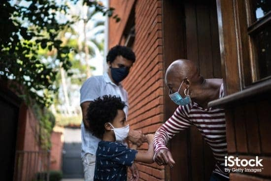 grandmother and grandson using elbow greeting picture id1265573340 > Exciting Photography Trends 2021