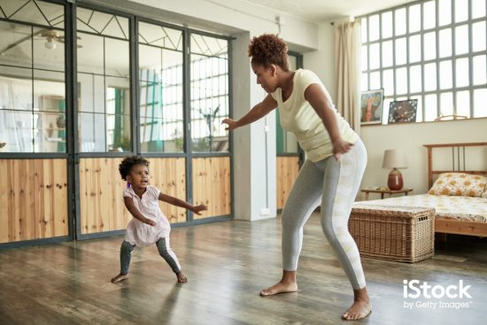 young mother and daughter doing dance exercises at home picture id1261143292 > Exciting Photography Trends 2021