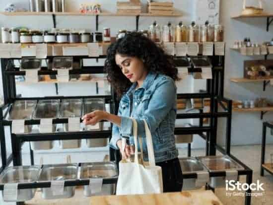 young woman using reusable shopping bag in store picture id1202789115 > Exciting Photography Trends 2021